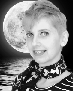 Smiling short haired blonde with neck scarf in black and white over a moon.
